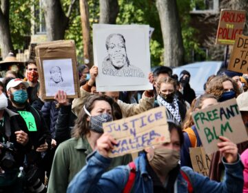 Protesters march from the scene of Walter Wallace Jr.'s killing to Malcolm X Park. (Emma Lee/WHYY)