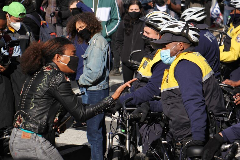 FILE - A protester yells at police who blocked a march on Pine Street. (Emma Lee/WHYY)