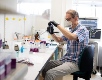 Preston Estep, head of RaDVac, at work in a Boston lab. (Image courtesy of Kayana Szymczak)