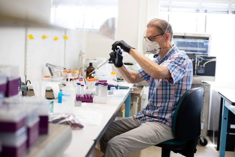 Preston Estep, head of RaDVac, at work in a Boston lab. (Image courtesy of Kayana Szymczak)