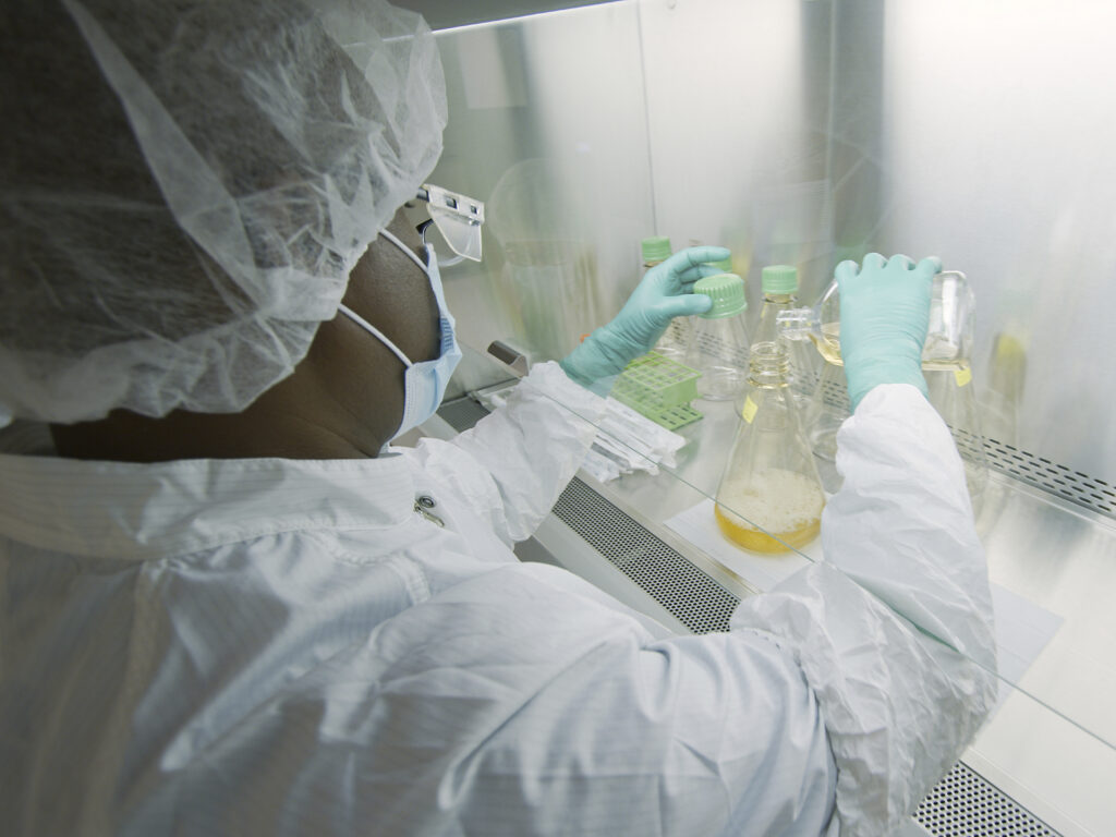 An Eli Lilly researcher tests possible COVID-19 antibodies in a laboratory