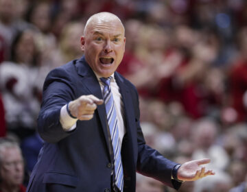 Penn State head coach Pat Chambers gestures in the second half of an NCAA college basketball game in Bloomington, Ind., Sunday, Feb. 23, 2020. Indiana defeated Penn State 68-60. (AP Photo/Michael Conroy)