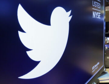 Twitter said it will make changes to how preview images are cropped amid concerns about possible bias. Some Twitter users posted images the site's algorithm selected white faces over Black ones in preview images. (Richard Drew/AP)