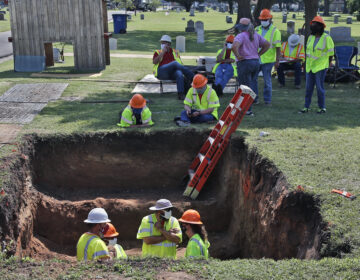 A second excavation is planned in Tulsa, Okla., this week to unearth potential unmarked mass graves from a race massacre in 1921. In July, researchers began excavation at Oaklawn Cemetery, shown here. They found no evidence of human remains at that particular excavation site. (Sue Ogrocki/AP)