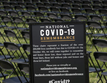 Hundreds of empty chairs who represent a fraction of the more than 200,000 lives lost due the COVID-19 are seen during the National COVID-19 Remembrance, at The Ellipse outside of the White House, Sunday, Oct. 4, 2020, in Washington. (AP Photo/Jose Luis Magana)