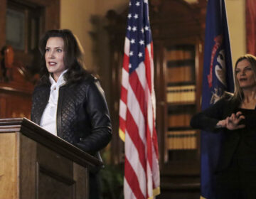 Michigan Gov. Gretchen Whitmer addresses the state during a speech Thursday in Lansing, Mich. Thirteen members of two militia groups face criminal charges after allegedly plotting to kidnap Whitmer.