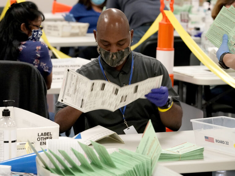 Election workers sort ballots