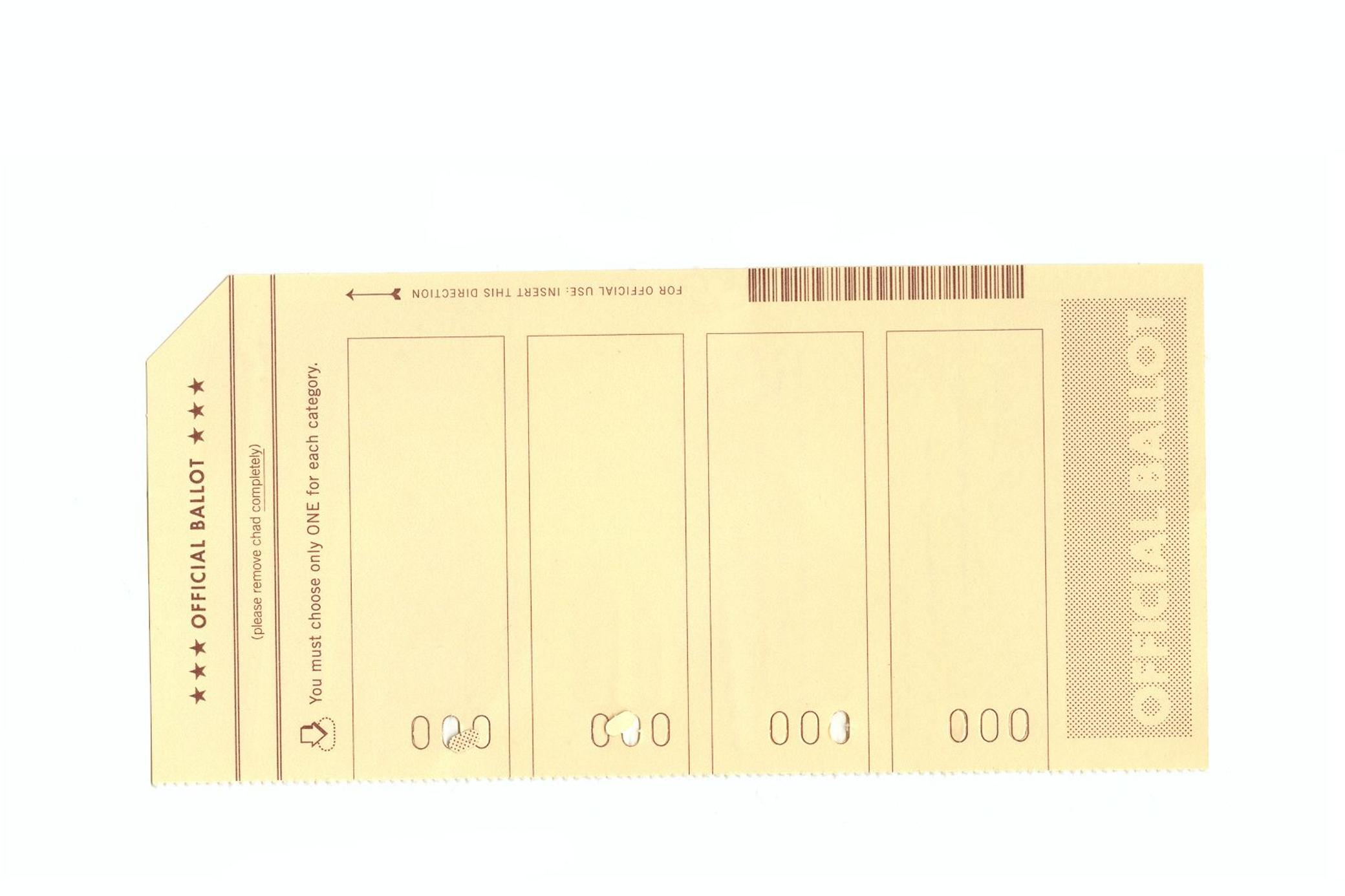 """This stock photo shows an example of a """"hanging chad,"""" created by an incompletely punched hole on a ballot."""