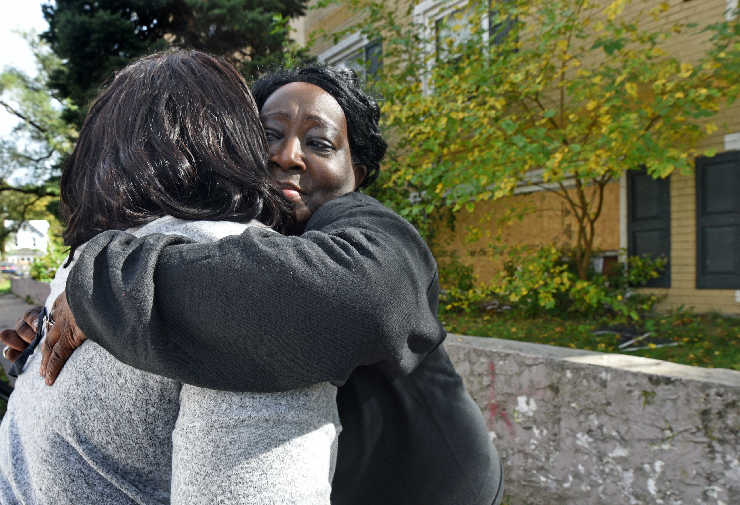 At the Cra-West Apartments in Camden on Oct. 27, tenant Pamela Mumford gets a hug after removing belongings from the apartment she shared with her daughter before the fire on Sunday