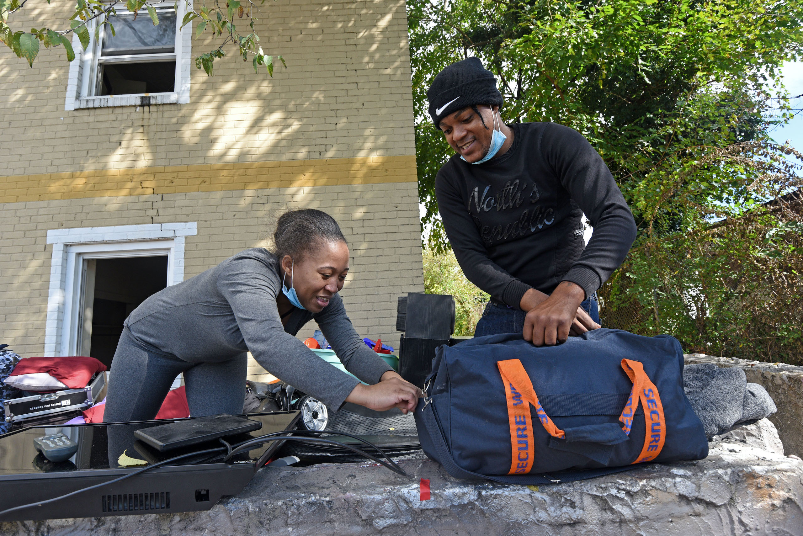 Dehna Morris and Elton Mundle remove belongings from their apartment