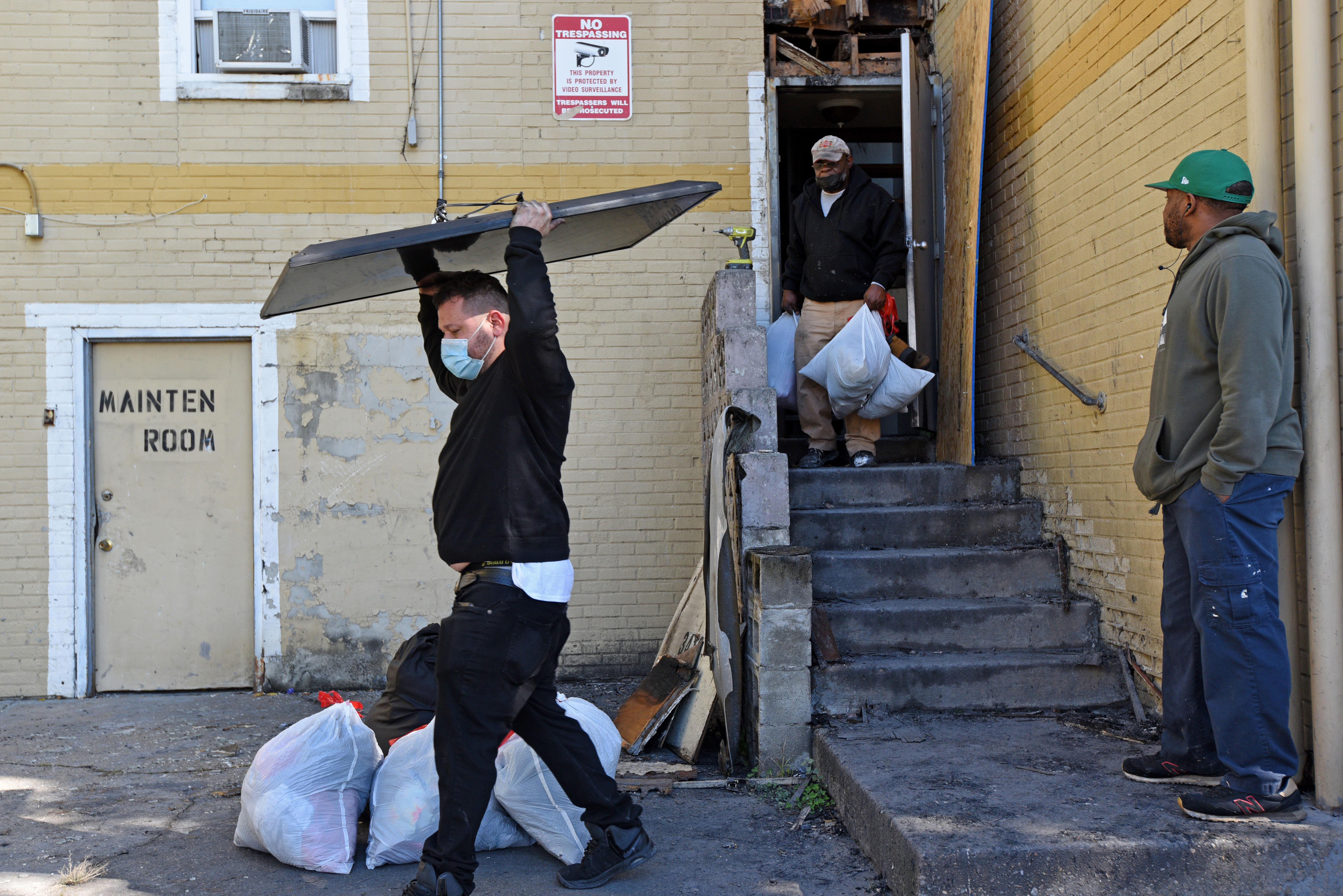 Tenants remove belongings from their apartments