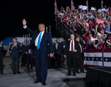 President Donald Trump arrives for a campaign rally at Harrisburg International Airport, Saturday, Sept. 26, 2020, in Middletown. U.S. Rep. Lloyd Smucker, R-Lancaster/York, is at far left. (Evan Vucci/AP Photo)