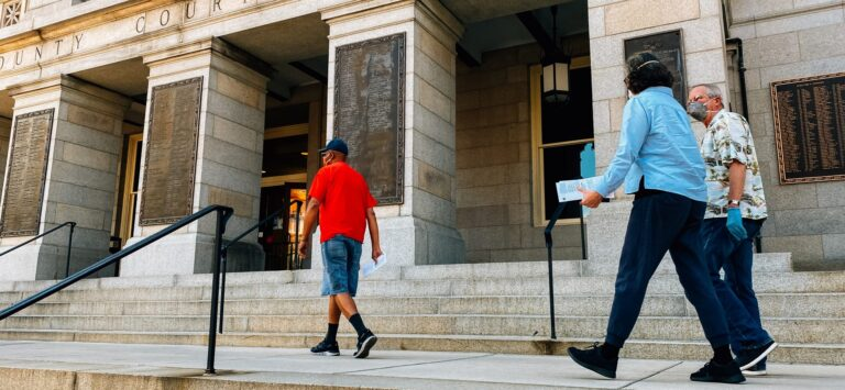 Voters walk along the steps of the York County Courthouse on June 1, 2020, to deposit their ballots in a drop box ahead of the Pennsylvania primary. (Kate Landis/PA Post)