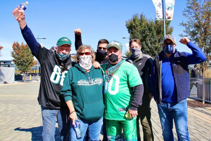 Paul and Sandy Edwards of Quakertown (foreground) and their friends (from left) John Fullerton, Jeff Morris, Tom Cooley, and Mark Lubenetski, arrive at the Linc to watch the first Eagles game of the season that is open to live fans
