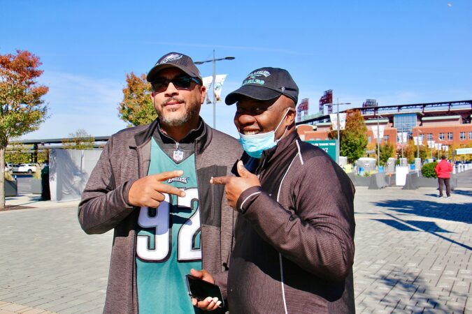College buddies James Griffin of Philadelphia and Norman Oliver of Wilmington get together at Lincoln Financial Field to watch the Eagles play