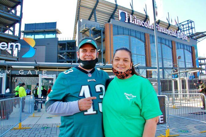 Chris Romanelli and his wife Jennifer prepare to enter Eagles stadium