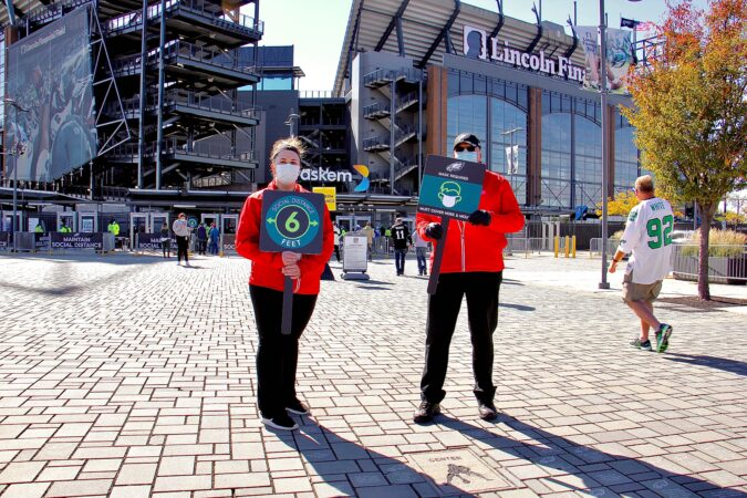 Game day staffers Nicole Teklits and Daniel Bittner outside the Linc