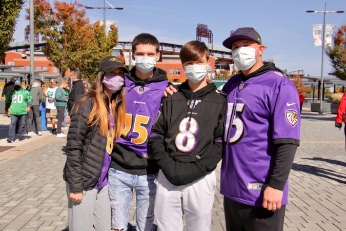 Tony Christianson (right) of Baltimore brings his family to the Eagles home game