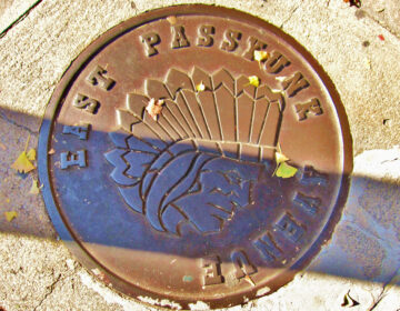 East Passyunk's current logo is seen on a utility hole cover
