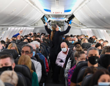 A plane full of masked people