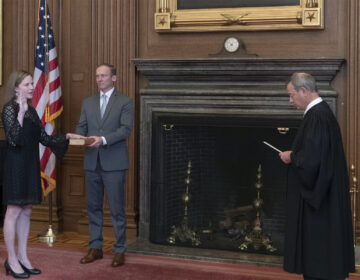 Chief Justice John G. Roberts, Jr., administers the judicial oath to Judge Amy Coney Barrett at the Supreme Court