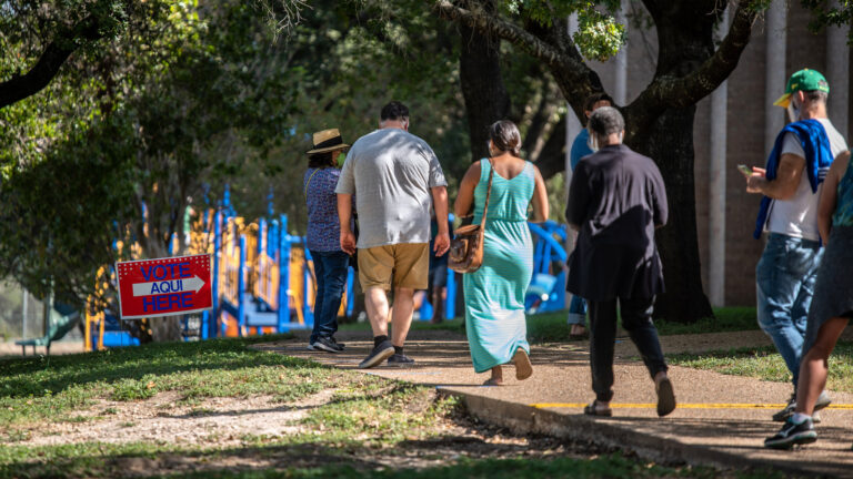 Voters approach a polling location in Austin, Texas, on Oct. 13 — the first day of voting in the state. Nearly 8 million votes already have been cast in Texas. (Sergio Flores/Getty Images)