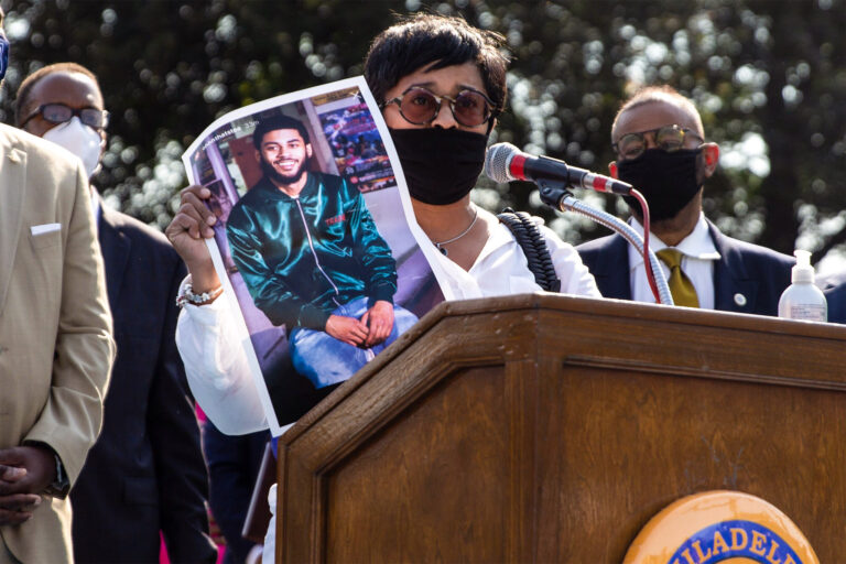 Tamika Morales holds a photo of her son Ahmad, who was killed July 2020 in South Philadelphia. (Kimberly Paynter/WHYY)