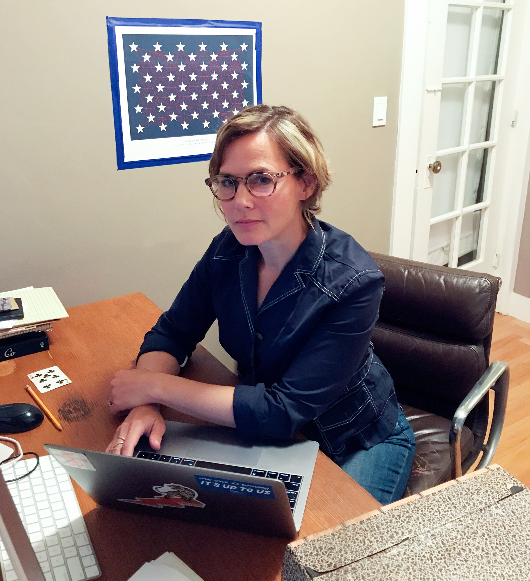 Jennifer Pahlka sits at a desk