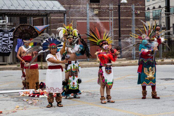 Aztec group Kapulli Kamaxtle Xiuhcoatl kick off Sunday's rally with a performance