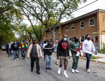 Members of the Richard Allen, Penn Town and Harrison housing communities hold a 'Put the Guns Down' peace walk through their neighborhood.