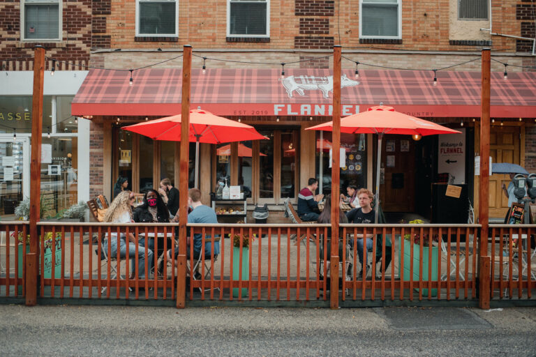 Customers sit and eat in a converted parking spot outside of Flannel, a restaurant in Philadelphia.