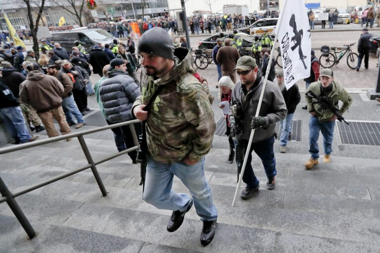 Protestors carrying rifles walk up the steps for a rally at the City County building on Monday, Jan. 7, 2019, in Pittsburgh. The protesters, many openly carrying guns, gathered in downtown Pittsburgh to rally against the city council's proposed restrictions and banning of semi-automatic rifles, certain ammunition and firearms accessories within city limits. (Keith Srakocic / AP Photo)