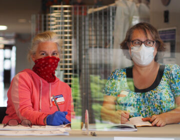 Poll workers took COVID safety precautions during the June primary. Many more voters are expected for the general. (Zach Hughes/WHYY)