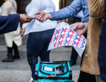 Voters receive a sticker after voting at one of Philadelphia's satellite election offices