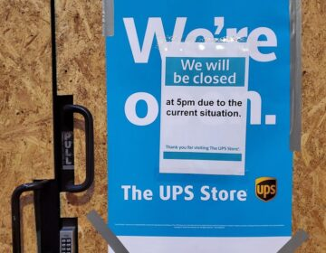 A boarded up UPS Store at 13th and Chestnut closed early Wednesday. (Mark Henninger/Imagic Digital)