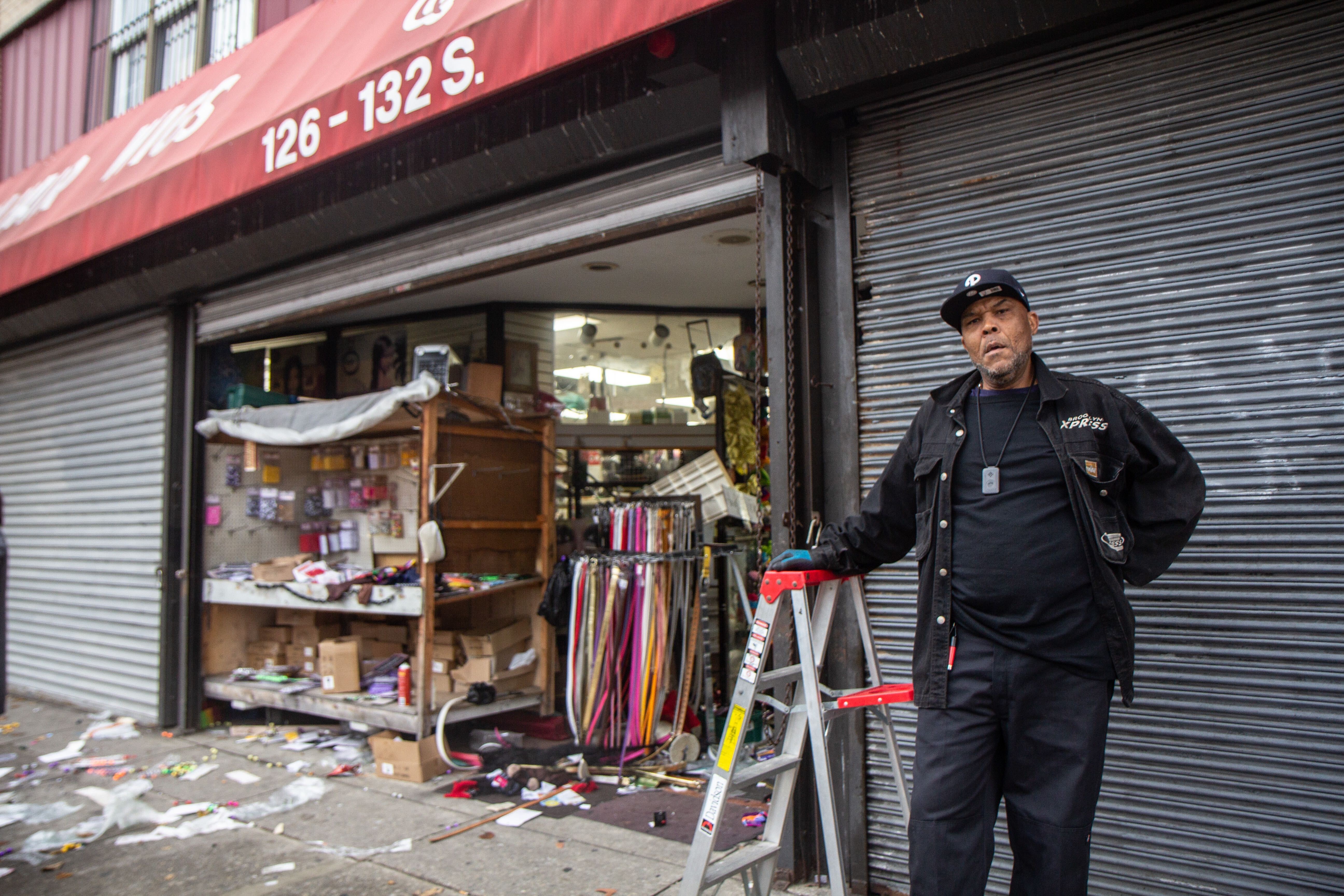 Steven Hall works at Q&S beauty supply and argues with bystanders defending looting on 52nd Street