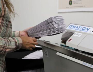 A worker processes mail-in ballots at the Cumberland County Bureau of Elections on Nov. 4, 2020.