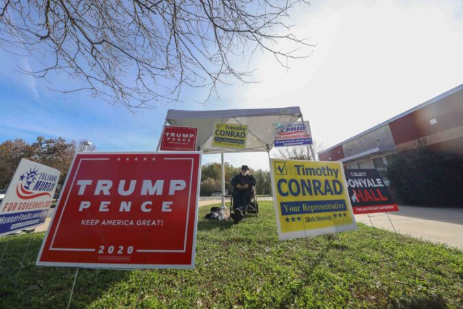 Campaign signage is displayed on election day Tuesday, Nov. 03, 2020, at Thurgood Marshall Elementary School in Newark, Del.(Saquan Stimpson for WHYY)