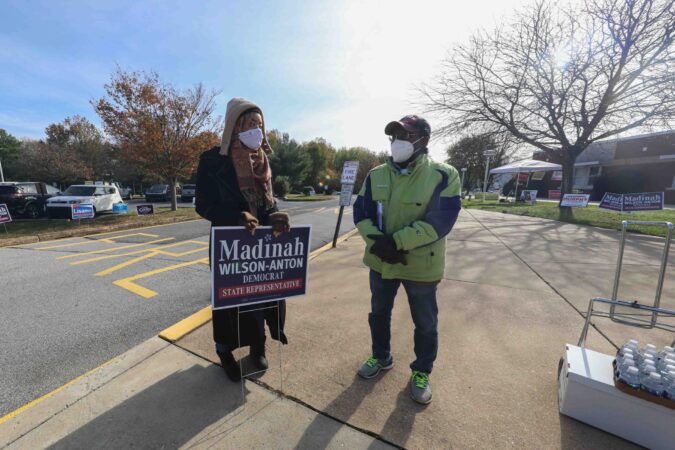 Madinah Wilson-Anton (left), candidate for  Delaware House of Representatives, speaks to a members of the public on election day Tuesday, Nov. 03, 2020, at Thurgood Marshall elementary school in Newark, Del. (Saquan Stimpson for WHYY)