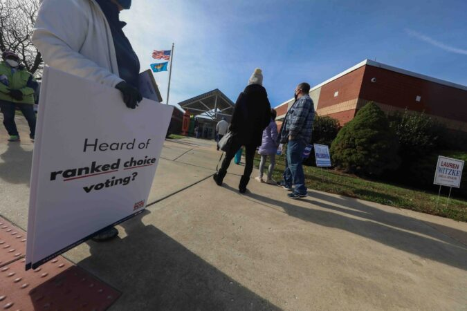 Voters wait in a long line in the cold to cast their vote on election day Tuesday, November 3, 2020, at Thurgood Marshall Elementary School in Newark, Del. (Saquan Stimpson for WHYY)