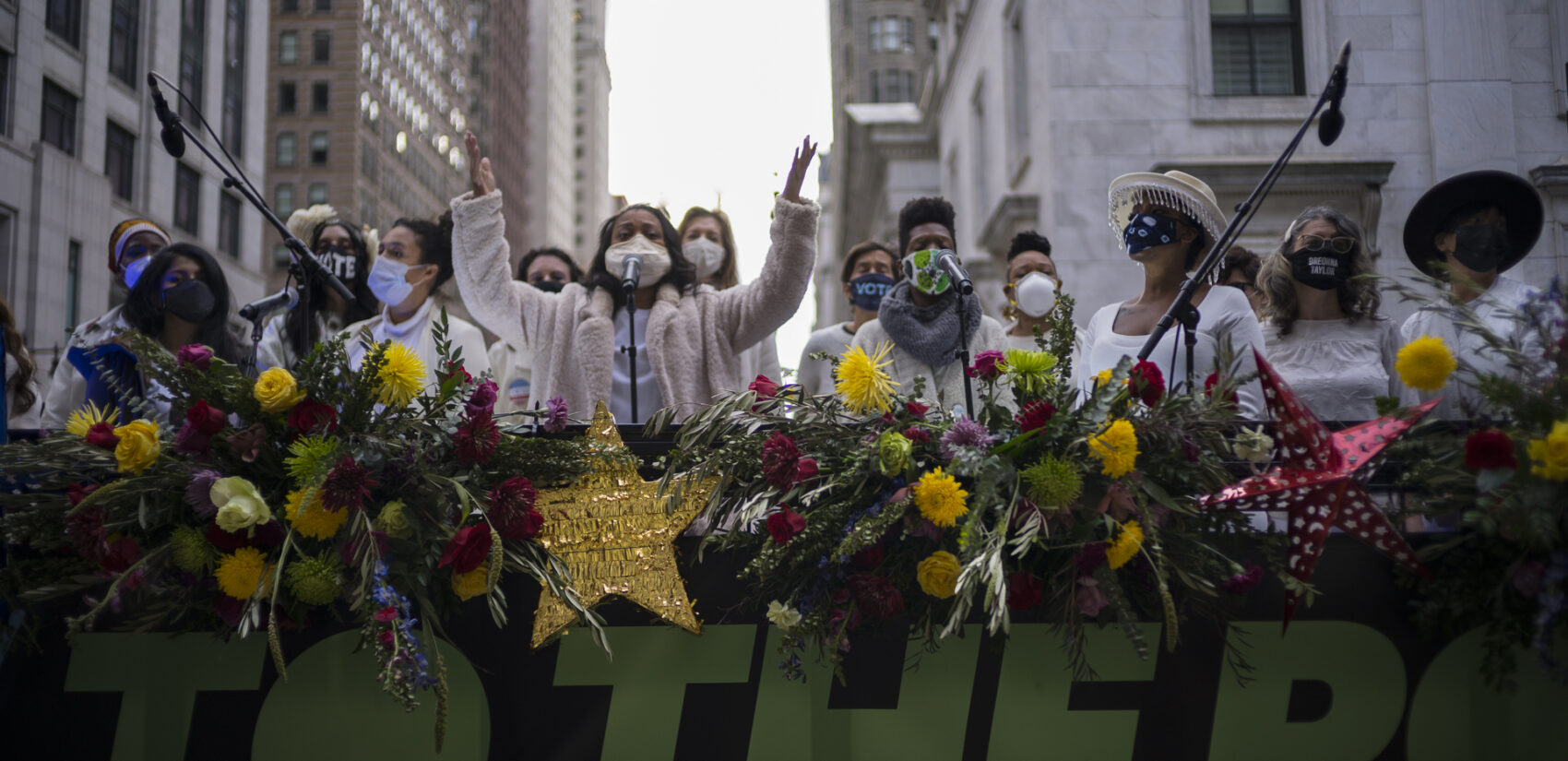 The Resistance Revival Chorus performs in front of City Hall, onboard a flatbed truck, as part of a voter motivational effort called