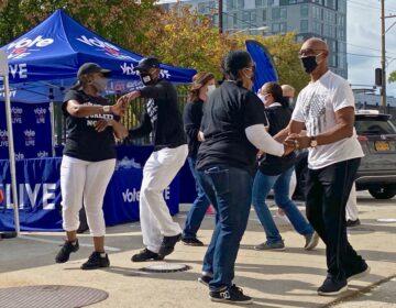 People salsa dancing outside