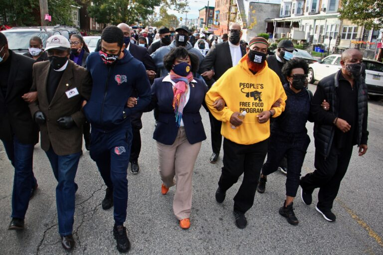 Community leaders and members of the clergy led a march Tuesday from the site where Walter Wallace Jr. was killed to the police precinct at 55th and Pine (Emma Lee/WHYY)