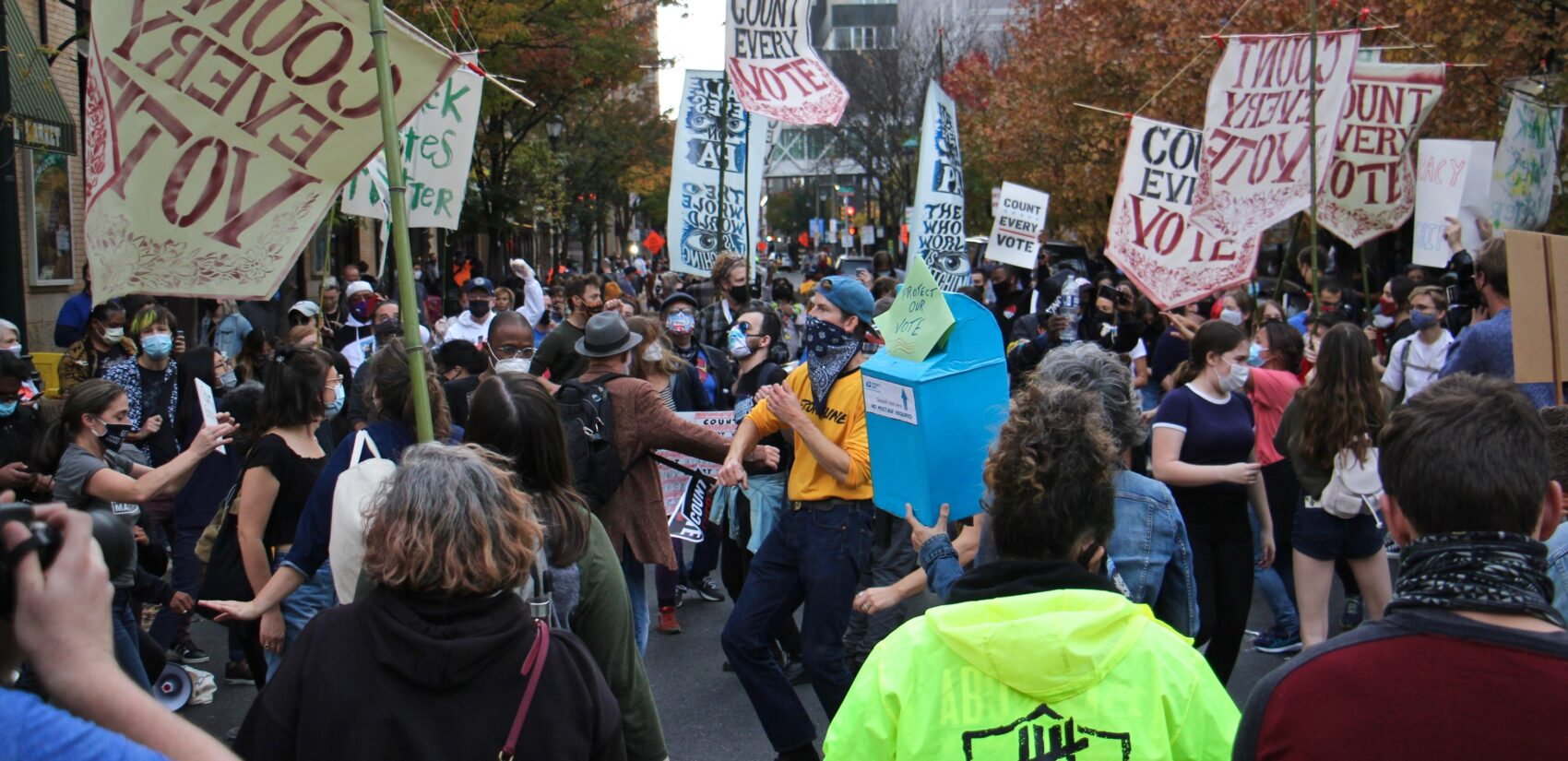Protesters dance in the street outside the Pennsylvania Convention Center, where Philadelphia's mail and absentee ballots are being counted
