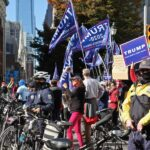 Philadelphia police create a buffer between dueling rallies outside the Pennsylvania Convention Center. (Emma Lee/WHYY)