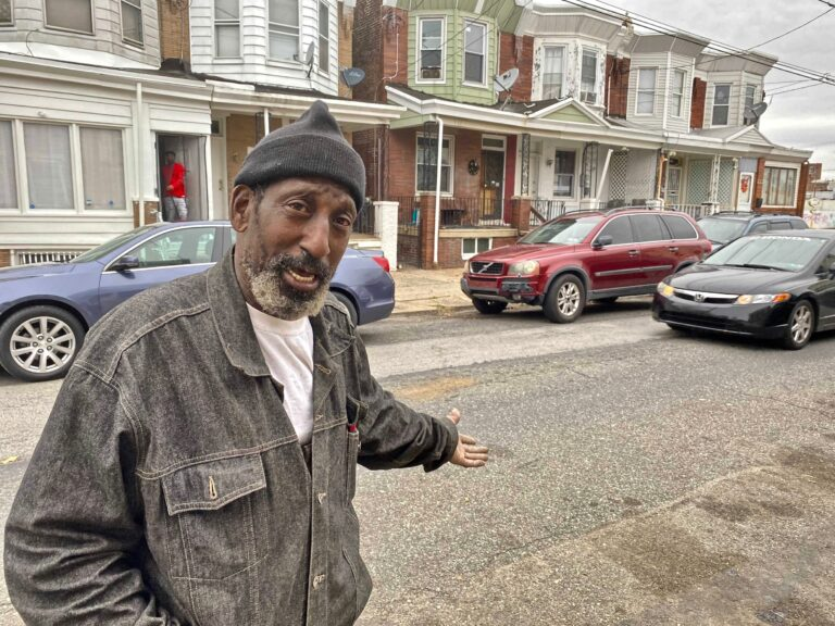 Roger 'Texas' Brown, 62, stands outside his home in the Frankford neighborhood Nov. 12, 2020. (Taylor Allen/WHYY)