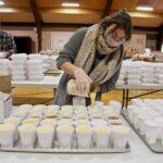 Jayne Clauss pours servings of gravy at St. Robert Bellarmine Church