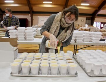 Jayne Clauss pours servings of gravy at St. Robert Bellarmine Church