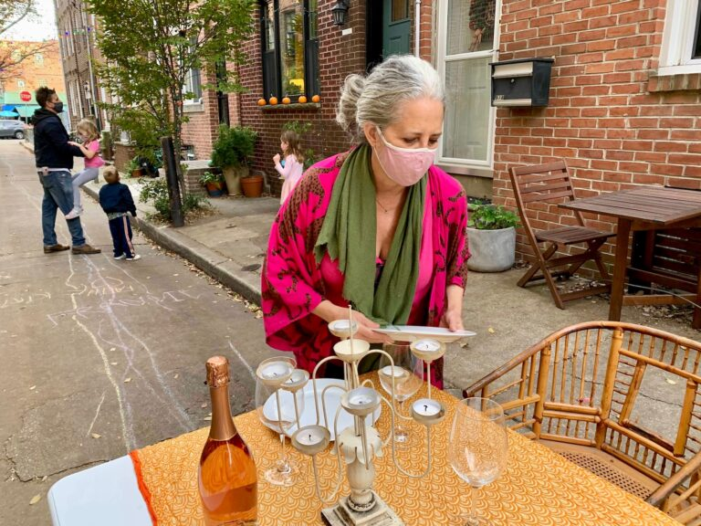 Martha Rich sets up tables to share with her neighbors on her street in South Philly.