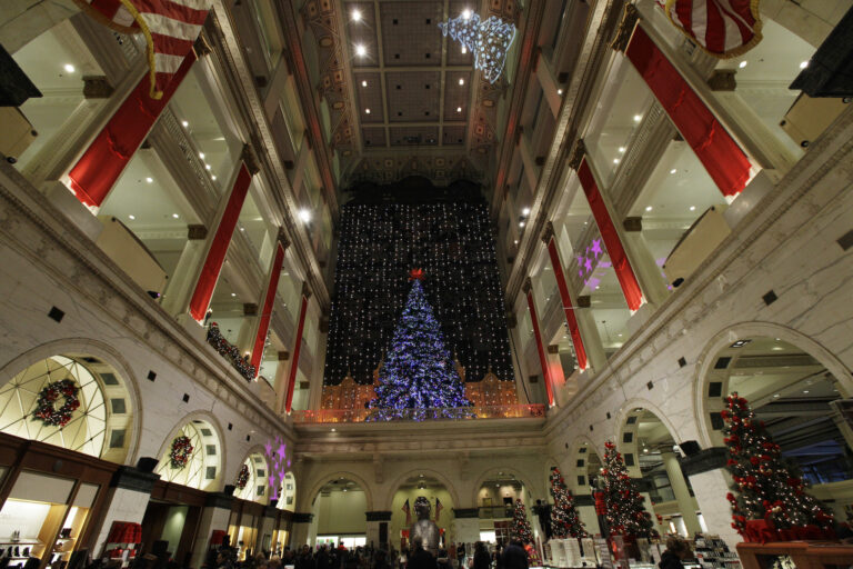 FILE - holiday lights are seen at Macy's in Philadelphia. The Wanamaker Grand Court Organ, installed nearly 100 years ago in this location, is the largest operational pipe organ in the world. (AP Photo/Matt Rourke)